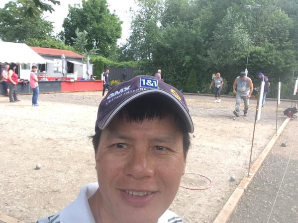 ... Philippe plays Petanque with me.