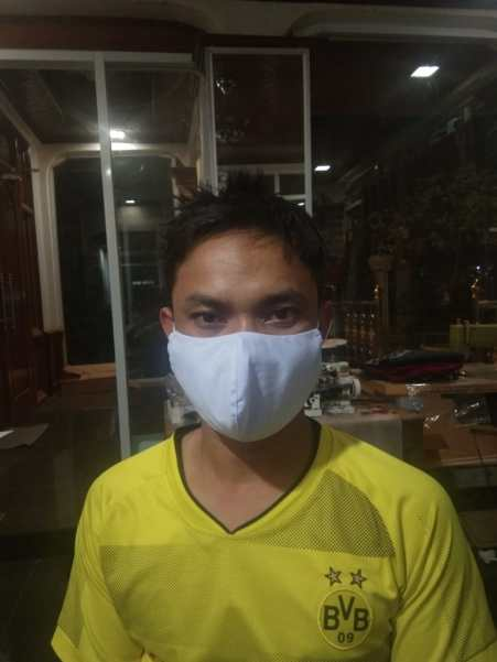 Mr Napha with his first self-made mask...