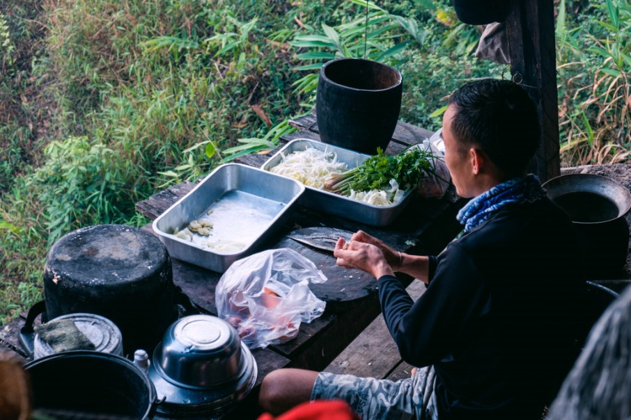 Ding cooks dinner at the camp.