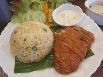 One of the café's best-sellers: Crispy chicken with fried rice