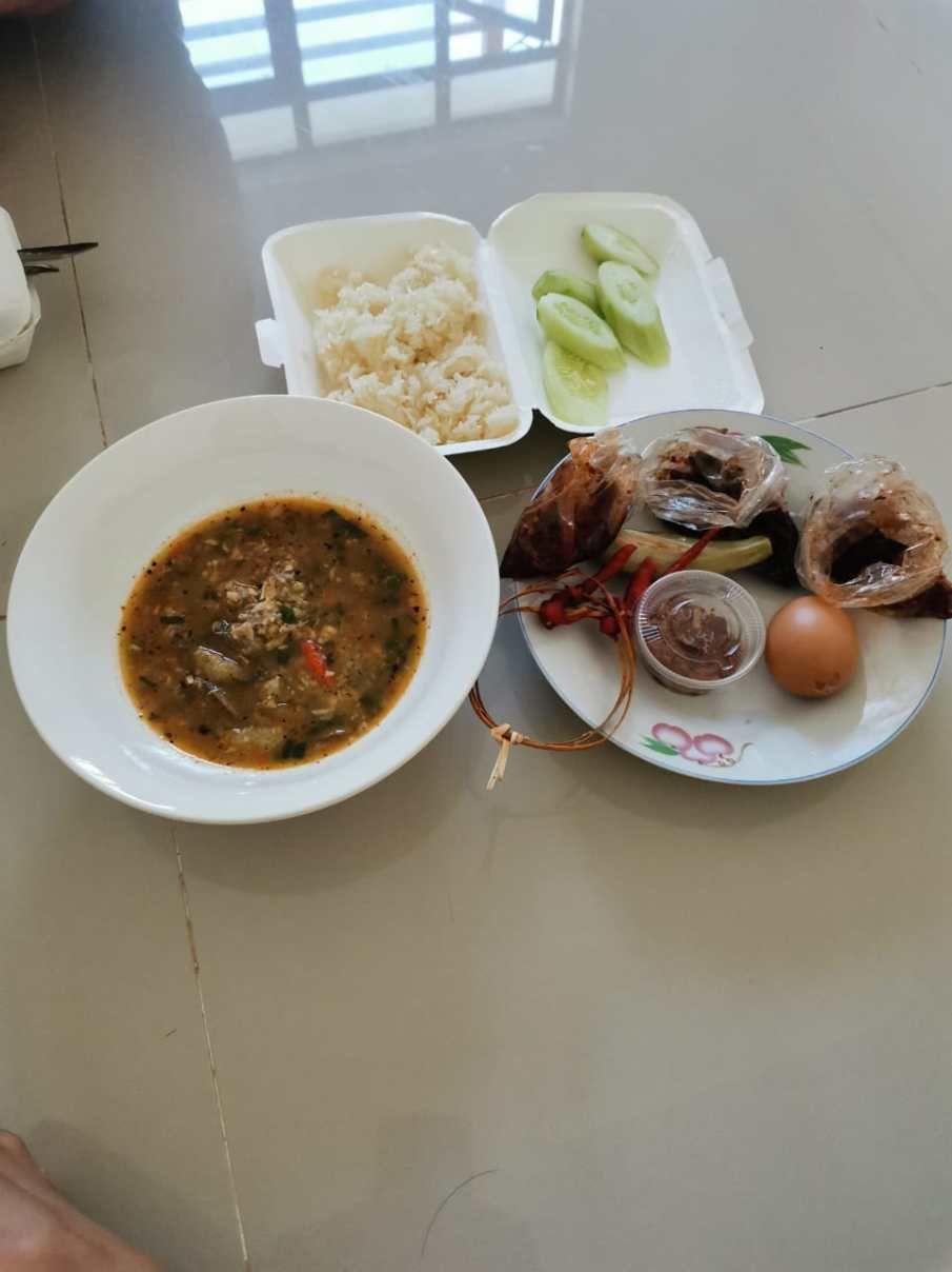 Fish sauce with sticky rice and boiled egg