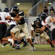Varsity Football: Cowboys Lose Close Game To Wildcats