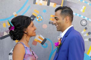 jas and ro in front of mural