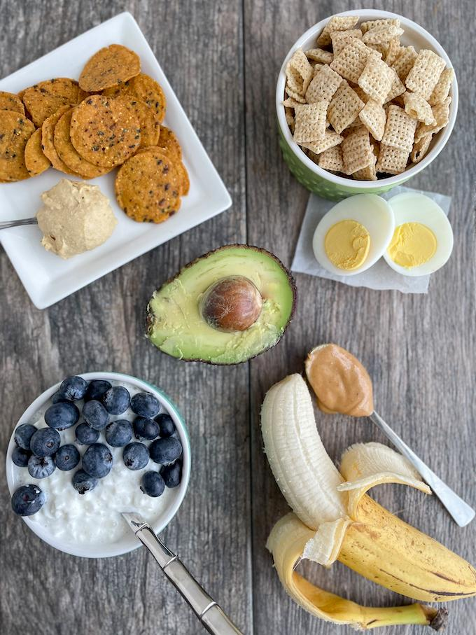 Healthy Toddler Snacks - cottage cheese, hummus, cereal, peanut butter with banana