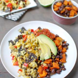 Tex-Mex Migas are a simple, vegetarian recipe that's perfect for lunch or dinner. Pairing it with a simple sweet potato and black bean hash adds some extra protein and fiber!