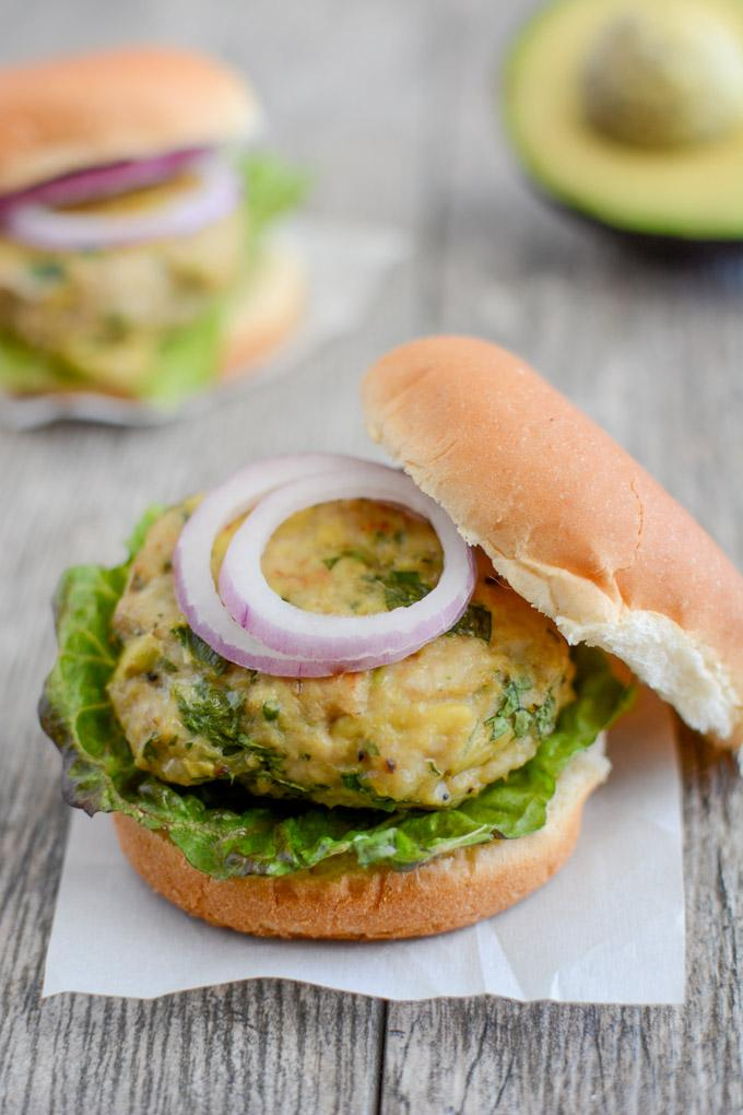 These Avocado Chicken Burgers are an easy weeknight dinner in the oven or on the grill. This recipe is gluten-free, paleo and can easily be made ahead of time during food prep.