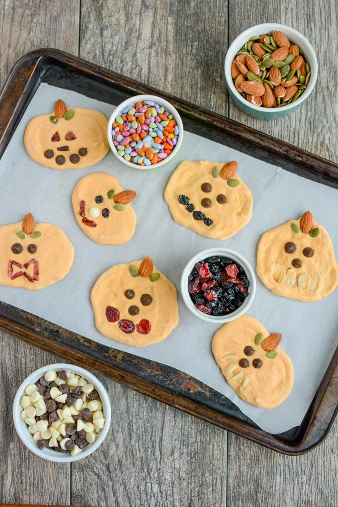 Pumpkin Yogurt decorated as jack-o-lanterns and frozen