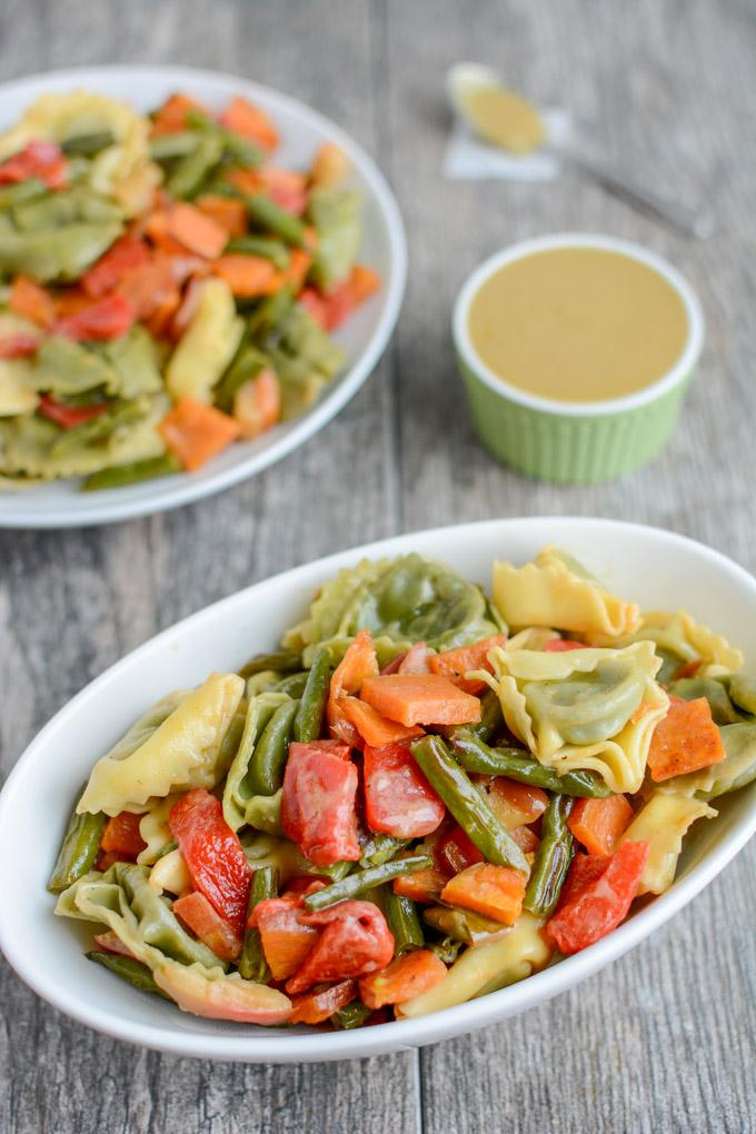 This Roasted Vegetable Pasta Salad with Maple Mustard Dressing is a simple, healthy vegetarian recipe. Serve it as an easy dinner side dish and pack the leftovers for lunch!