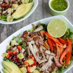 This Pulled Pork Fajita Salad is the perfect way to transform leftover pulled pork into a healthy new lunch or dinner. A pineapple black bean salsa and a light cilantro-lime dressing add extra flavor!
