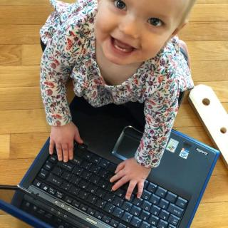toddler with computer