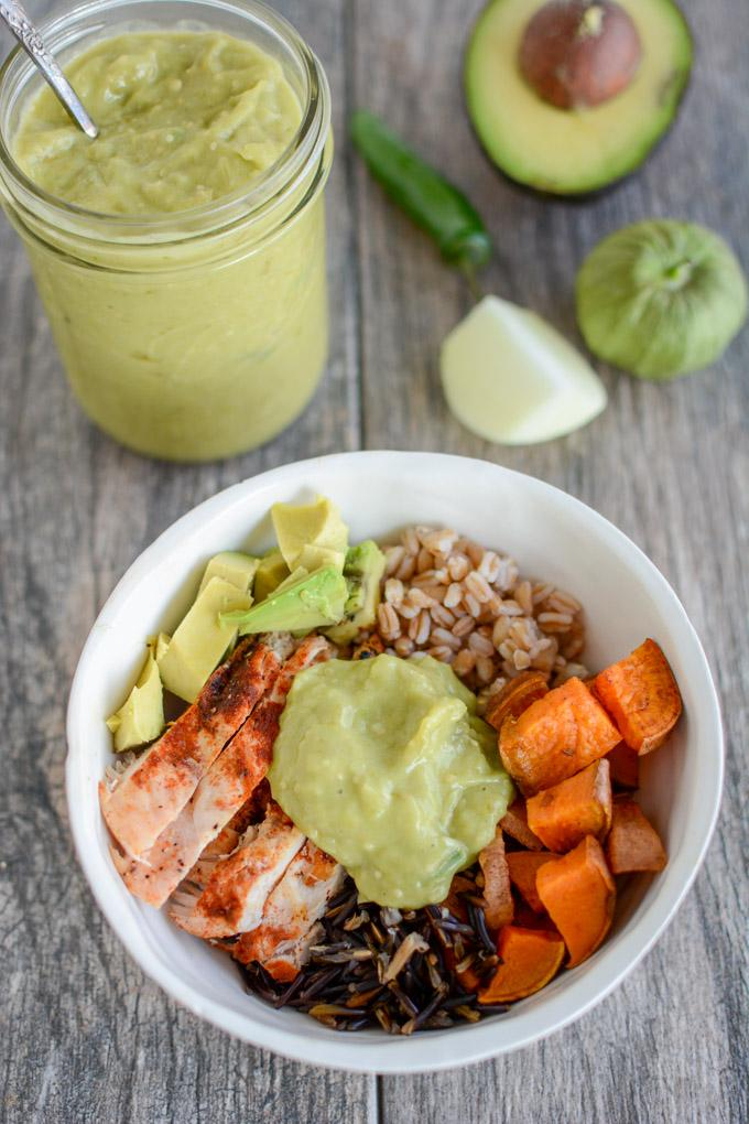 Spicy Green Sauce on a bowl of chicken, roasted vegetables, farro and wild rice.