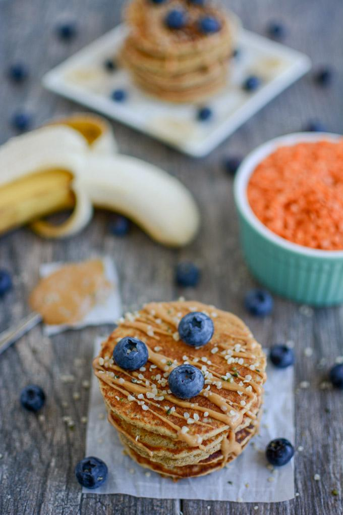 Red Lentil Pancakes topped with blueberries and peanut butter