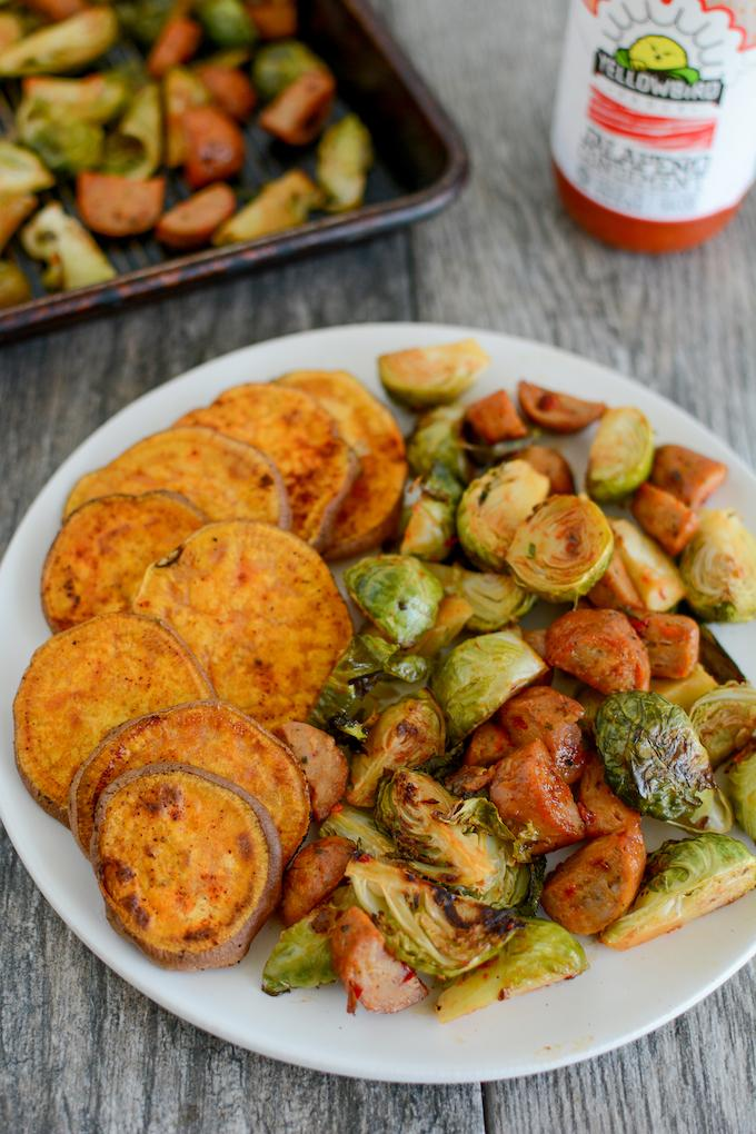 Oven Roasted Brussels Sprouts with chicken sausage and a side of roasted sweet potatoes