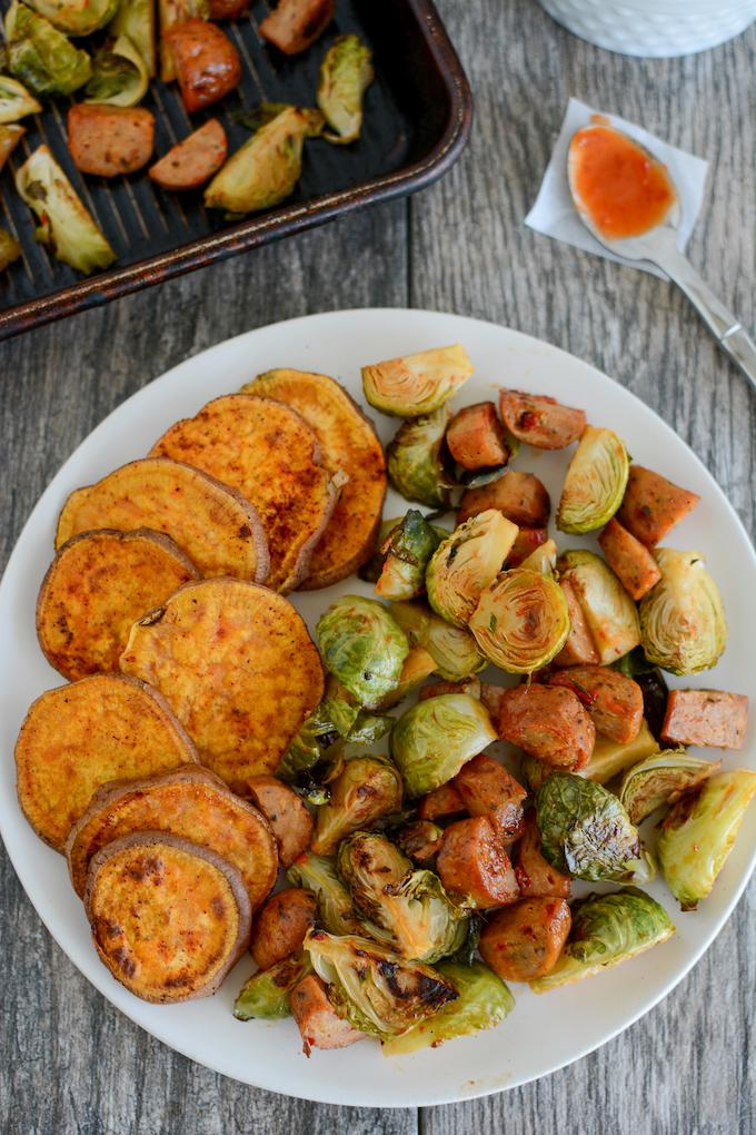 Sweet and Spicy Oven Roasted Brussels Sprouts with chicken sausage and sweet potatoes
