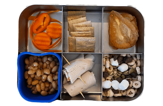 lunch box for kids with baked beans, turkey cheese roll up, trail mix and dried pears
