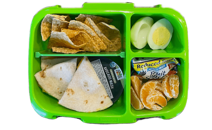 easy kids lunch - quesadilla, chips and guacamole, hard boiled egg, clementine and fruit snacks