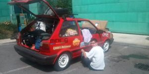 Applying stickers in a service station on the A40