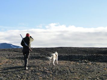 Hiking guide with gun and dog