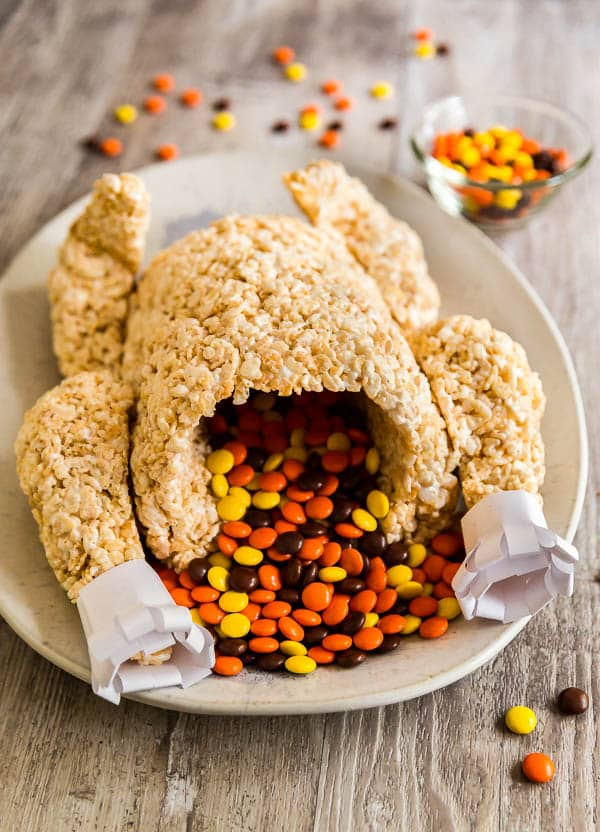 An image of a Rice Krispie Treat Turkey with Reese's Pieces stuffed in it.