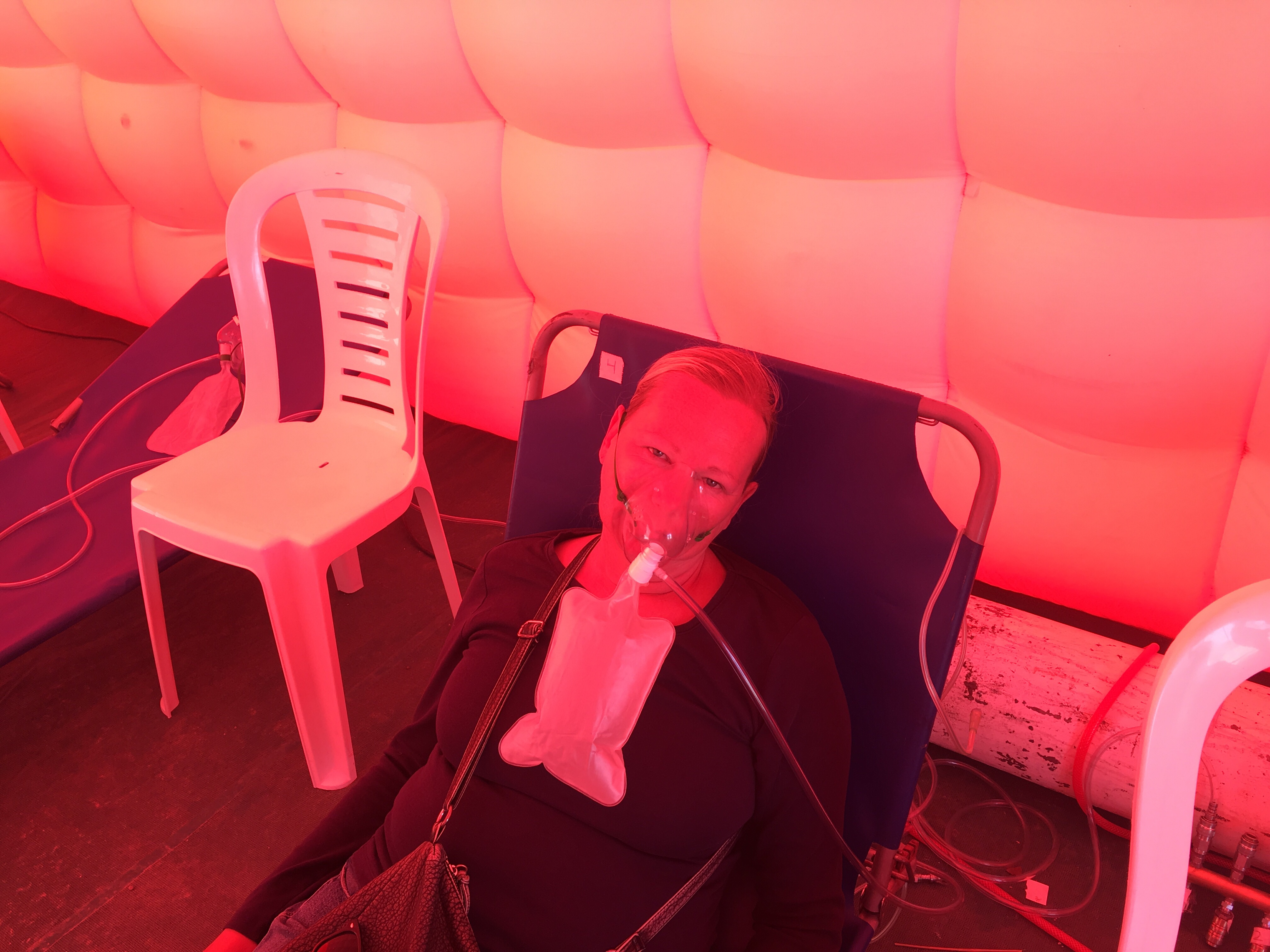 Cate resting with an oxygen mask on her face at Paso Jama, Argentina after suffering side effects from altitude sickness.