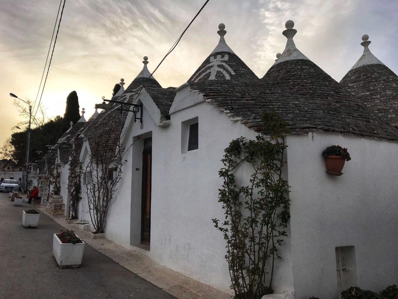 Sunset setting over the trulli houses in Alberobello