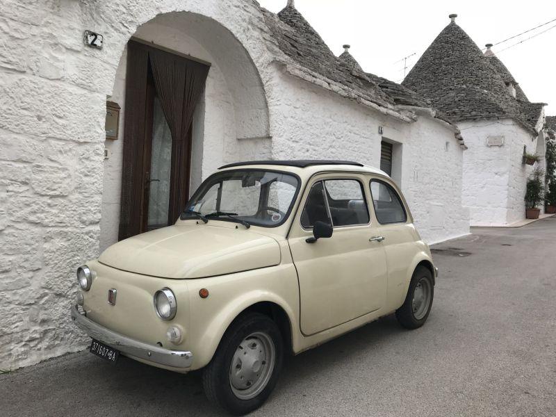 Puglia road trip mini fiat 500 in Alberobello Puglia Southern Italy