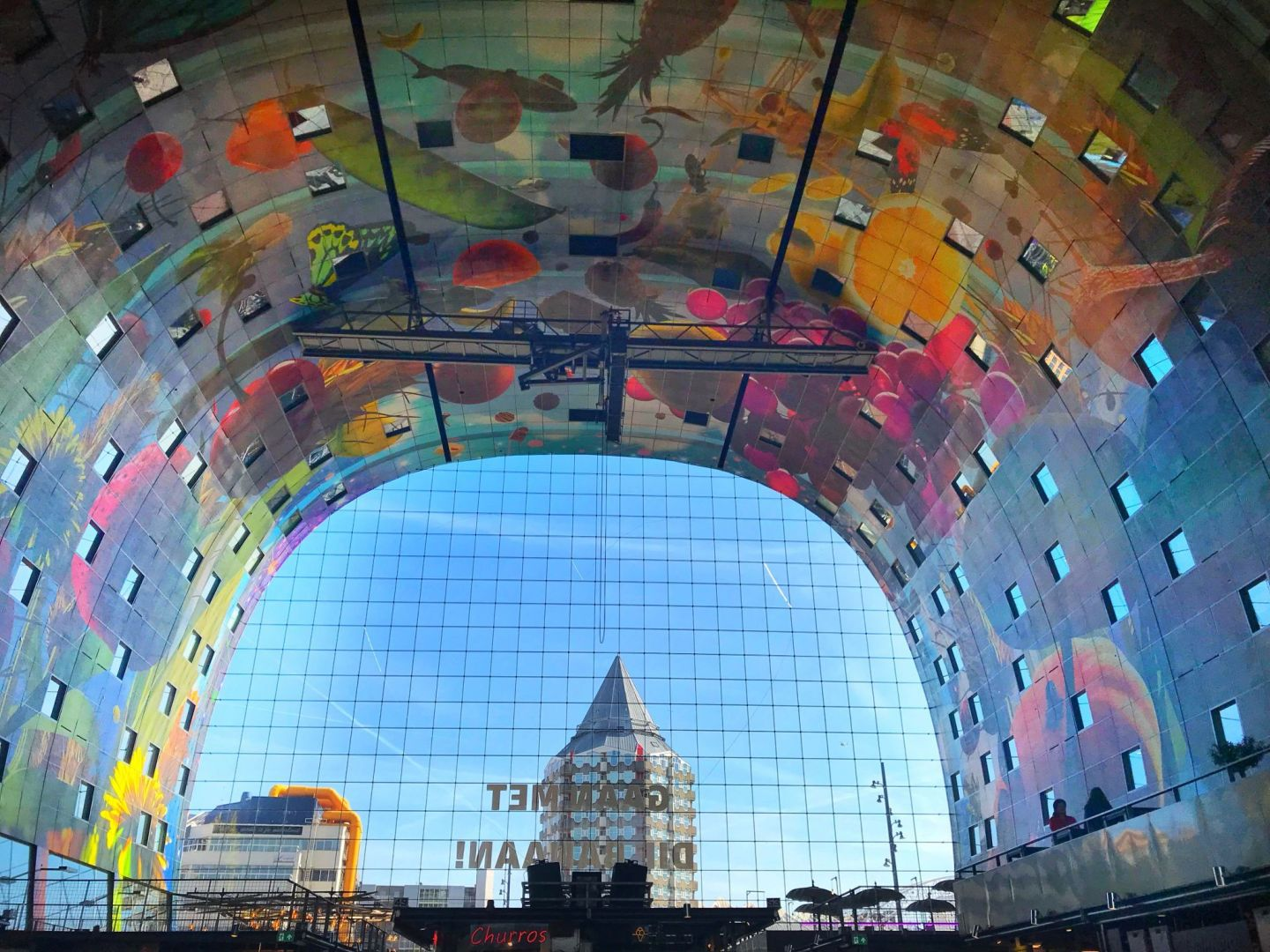 Colourful view of Het Pootlood Pencil Building from Markthal Rotterdam