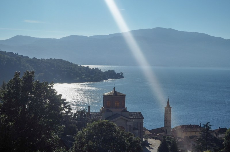 Sunray lightening bolt through Santi Filippo E Giacomo Bell Tower Laveno Mombello