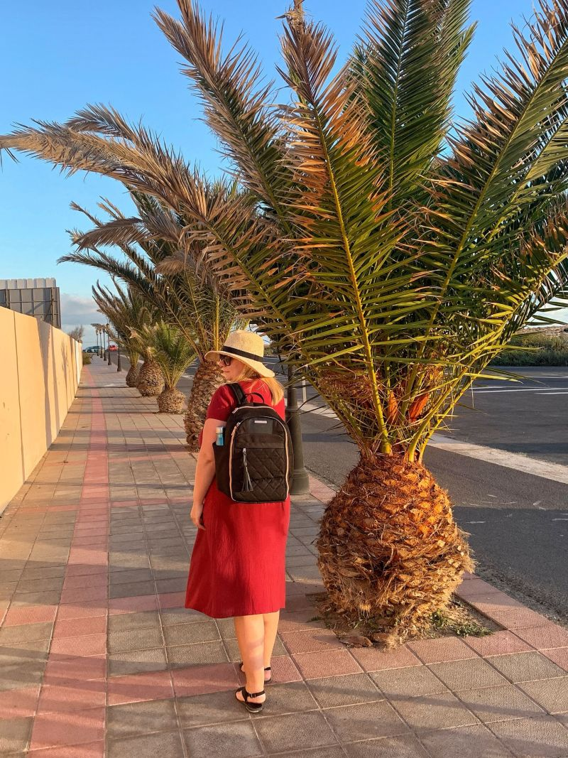 Me & my Travel Hack Backpack (side glance view) Travel Hack Backpack - Best Carry-On Bag for a Woman with Style