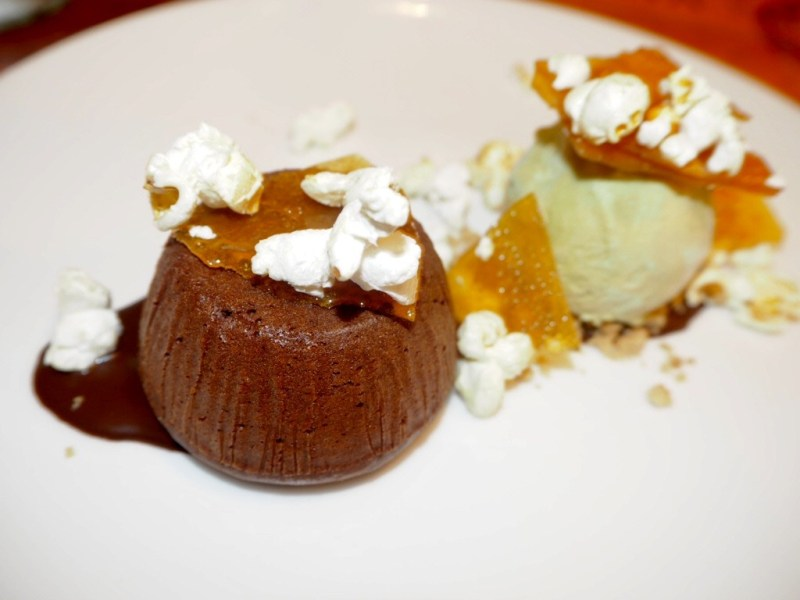 Warm Chocolate fondant with salted caramel popcorn and pistachio icecream The Embankment Pub Bedford