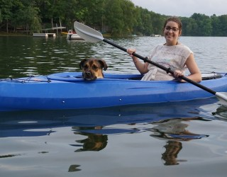 Wendy and Finn kayaking on a lake