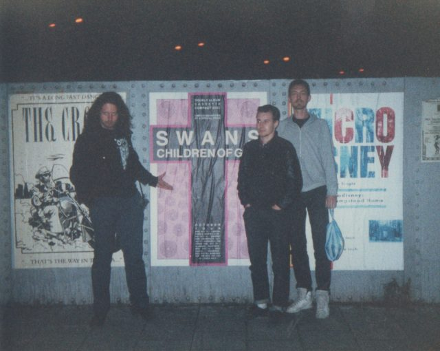 AL NORMAN ROB IN FRONT OF POSTER