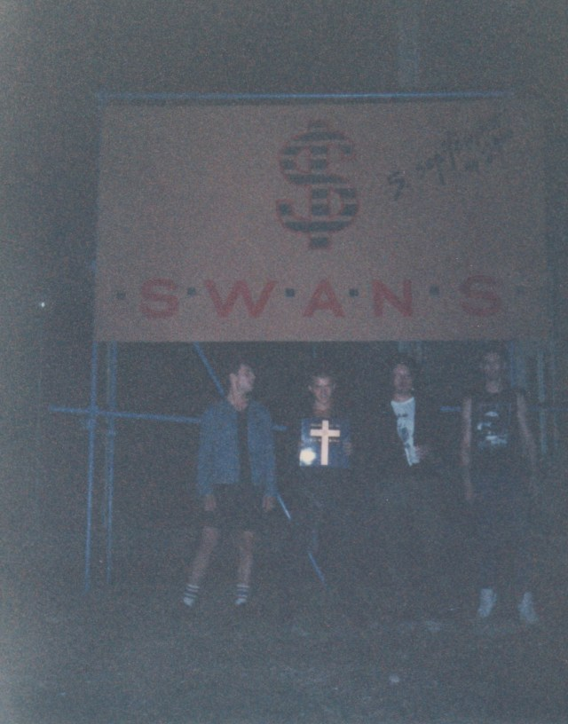 POSING IN FRONT OF BIG BANNER (1)
