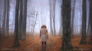 Woman Walking Foggy Forest During Autumn