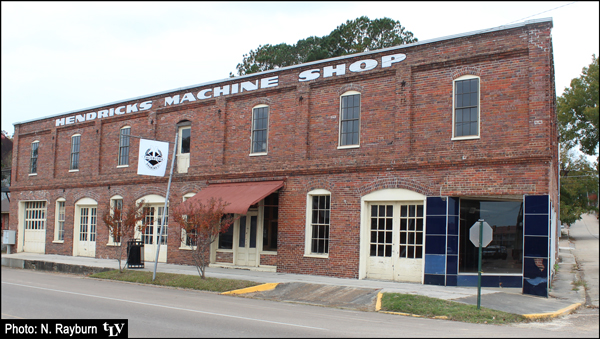 """Outside of Yalobusha Brewing Company building in Water Valley - with """"Hendricks Machine Shop"""" still painted on the wall's top edge"""