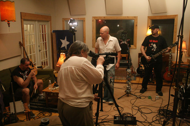 """Oxford Sounds"" Producer Marie Antoon films a scene with The Cooters and music Producer Winn McElroy at Black Wings Studio near Water Valley, Mississippi. Photograph by Newt Rayburn."