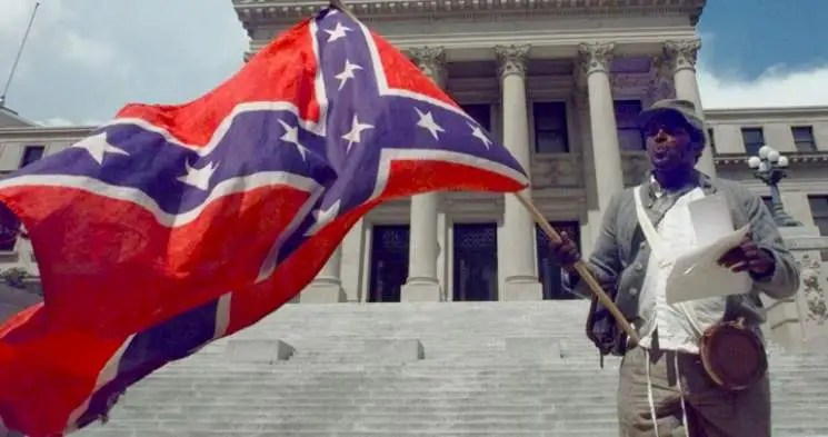 Anthony Hervey demonstrating on the steps of the Mississippi Capital building in 2001, during the sessions to legally establish Mississippi's state flag.