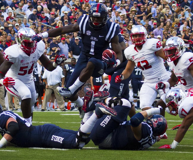 Laquon Treadwell hurdles everybody to advance the Ole Miss agenda against the Fresno State Bulldogs on Saturday, September 12, 2015. - Photograph by Shelby Rayburn - The Local Voice.