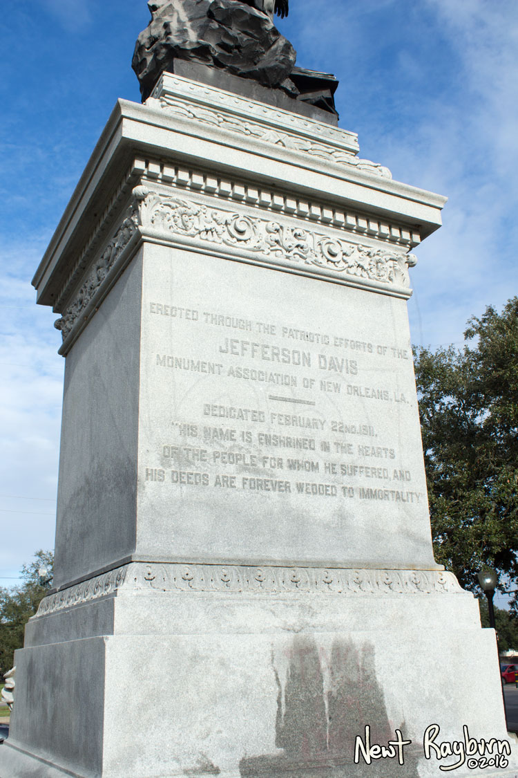 """The Jeff Davis Monument on January 2, 2016, at the intersection of Canal Boulevard and Jefferson Davis Parkway in New Orleans, Louisisana. Photograph © 2016 Newt Rayburn – newtrayburn@gmail.com. Inscription reads, """"ERECTED THROUGH THE PATRIOTIC EFFORTS OF THE JEFFERSON DAVIS MONUMENT ASSOCIATION OF NEW ORLEANS, LA. DEDICATED FEBRUARY 22ND 1911. 'HIS NAME IS ENSHRINED IN THE HEARTS OF THE PEOPLE FOR WHOM HE SUFFERED, AND HIS DEEDS ARE FOREVER WEDDED TO IMMORTALITY.'"""""""