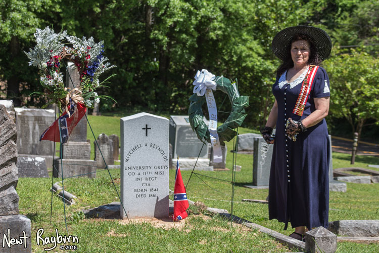 Lani Burnette Rinkel at the gravesite of Mitchell A. Reynolds, a Confederate soldier from the University Greys company. Photograph by Newt Rayburn - © May 6, 2018.
