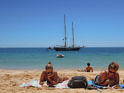 The perfect vacation: blue sky, inviting water, warm sand, and a great book.  Matt Knott via Flickr, 6/6/2012