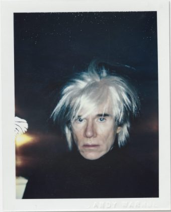 Andy Warhol, Self-Portrait in Fright Wig, 1986, Polacolor ER, 10.8 x 8.5 cm. © 2018 The Andy Warhol Foundation for the Visual Arts, Inc. Licensed by DACS, London. Courtesy BASTIAN, London