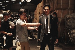 Director/Screenwriter directing Jung-jae Lee while filming 'New World'