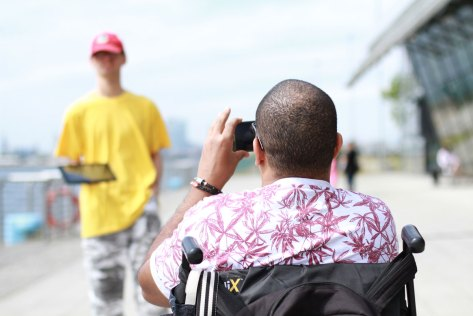 Event-photography-man-in-wheelchair-taking-photo-of-his-friend