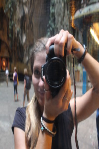 Snapping a reflected selfie with my Canon 600D.