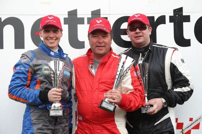 (L-R) Halliday, Walker and Deacon celebrate on the Lotus Cup UK podium
