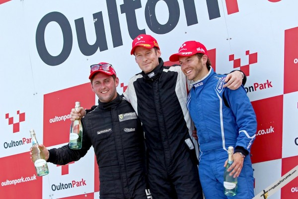 Adam Gore (centre) has been joined by team mate Jason Baker (right) on the podium as fought Fulvio Mussi (left) for the Elise Trophy title.
