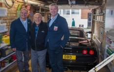 L-R Andrew Lang, Sir Stirling Moss, David Darling, Exige LF1 #1