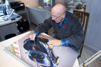 Sir Stirling signing charity poster