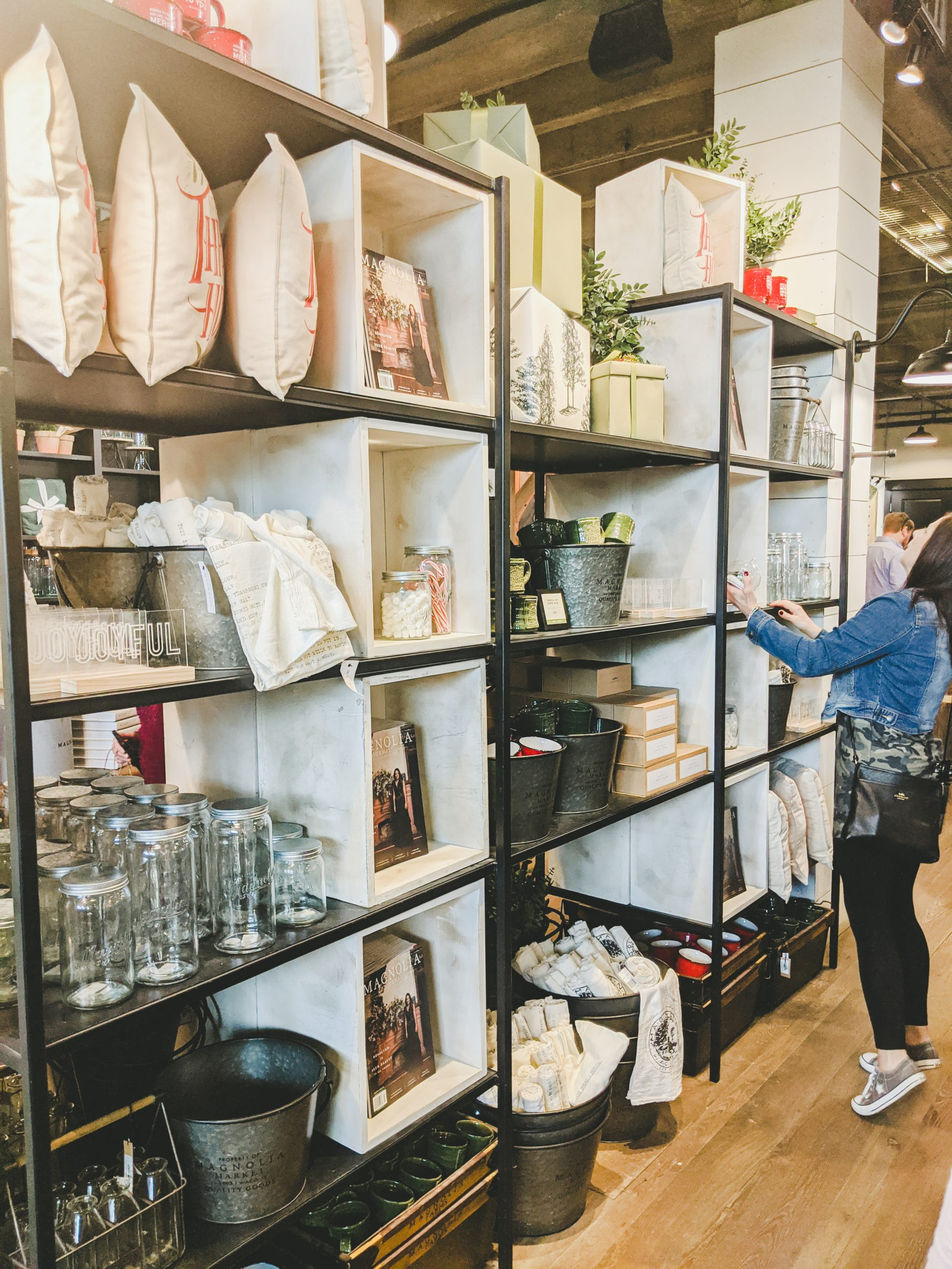 magnolia market display shelf with pillows